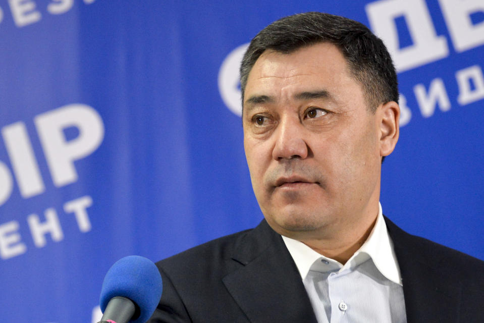 Sadyr Zhaparov, the top presidential candidate speaks to the media after the presidential election in Bishkek, Kyrgyzstan, Sunday, Jan. 10, 2021. A nationalist politician who was released from prison amid protests that overthrew Kyrgyzstan's president last year has been elected as his replacement. Voters in Sunday's election that gave Sadyr Zhaparov a landslide victory also approved a referendum to change the constitution to give the presidency more power. (AP Photo/Vladimir Voronin)