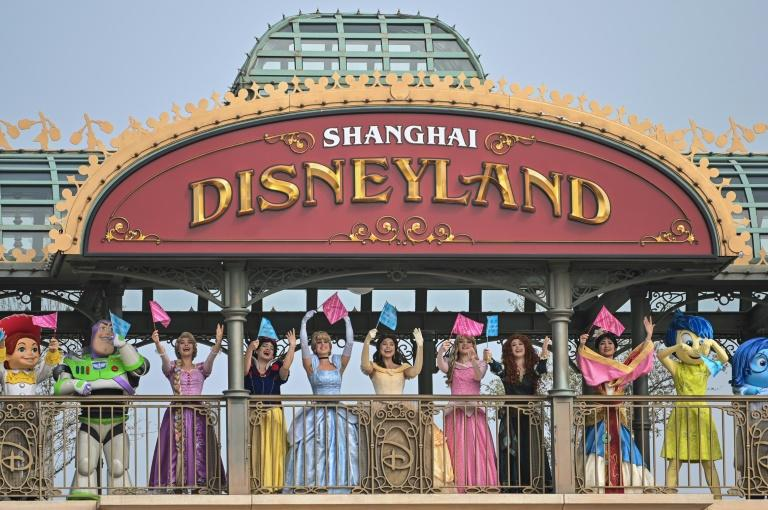 Disney hopes the reopening of its park in Shanghai will help temper the financial hit from coronavirus (AFP Photo/Hector RETAMAL)