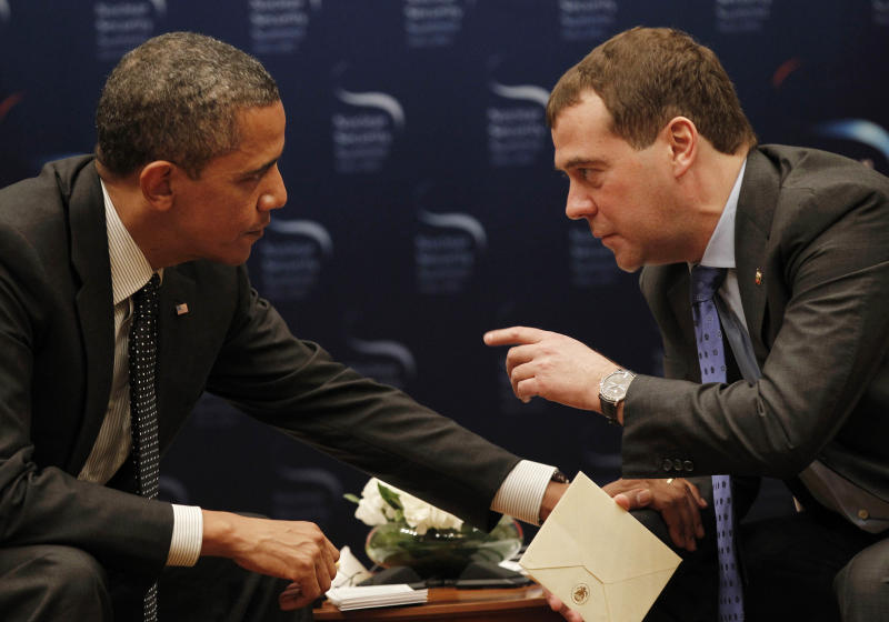 """FILE - In this March 26, 2012, file photo, President Barack Obama, left, chats with Russian President Dmitry Medvedev during a bilateral meeting at the Nuclear Security Summit in Seoul, South Korea. Mitt Romney's remarks disparaging 47 percent of Americans are the latest in a string of poorly chosen words that play into Democrats' portrayal of him as out of touch. But he's not the only one plagued by a campaign gaffe deemed elitist by critics. an open microphone caught Obama telling Russia's outgoing president that he needed space to work out their disagreements over U.S. missile defense plans. """"After my election, I have more flexibility,"""" Obama quietly told Medvedev, who said he would carry that message home. Romney called it evidence that Obama is hiding a secret agenda for a second term. (AP Photo/Pablo Martinez Monsivais, File)"""