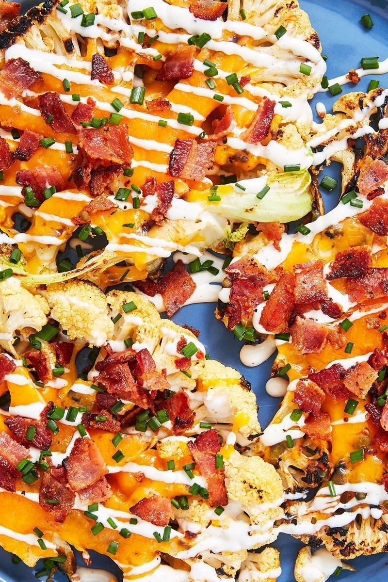 """<p>It's no secret that we LOVE <a href=""""https://www.delish.com/uk/cooking/recipes/g30687448/cauliflower-recipes/"""" rel=""""nofollow noopener"""" target=""""_blank"""" data-ylk=""""slk:cauliflower"""" class=""""link rapid-noclick-resp"""">cauliflower</a> here at Delish. From <a href=""""https://www.delish.com/uk/cooking/recipes/a31182680/cauliflower-baked-ziti-recipe/"""" rel=""""nofollow noopener"""" target=""""_blank"""" data-ylk=""""slk:Cauliflower Baked Ziti"""" class=""""link rapid-noclick-resp"""">Cauliflower Baked Ziti</a> to <a href=""""https://www.delish.com/uk/cooking/recipes/a29782837/cauliflower-grilled-cheese-recipe/"""" rel=""""nofollow noopener"""" target=""""_blank"""" data-ylk=""""slk:Cauliflower Grilled Cheese"""" class=""""link rapid-noclick-resp"""">Cauliflower Grilled Cheese</a>, no weird or wacky preparation has gone untried. Of all the different ways to prepare this lovely vegetable, grilling might be our favourite. The steaks still have a bit of crunch, and the smoky flavour plays well with melty cheese and creamy ranch dressing</p><p>Get the <a href=""""https://www.delish.com/uk/cooking/recipes/a32996503/loaded-grilled-cauliflower-recipe/"""" rel=""""nofollow noopener"""" target=""""_blank"""" data-ylk=""""slk:Loaded Grilled Cauliflower"""" class=""""link rapid-noclick-resp"""">Loaded Grilled Cauliflower</a> recipe.</p>"""