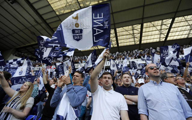 "Tottenham fans wave flags ahead of an English Premier League soccer match against <a class=""link rapid-noclick-resp"" href=""/soccer/teams/manchester-united/"" data-ylk=""slk:Manchester United"">Manchester United</a> last year. (AP)"