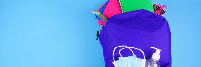 Backpack full of school supplies and COVID 19 prevention supplies.