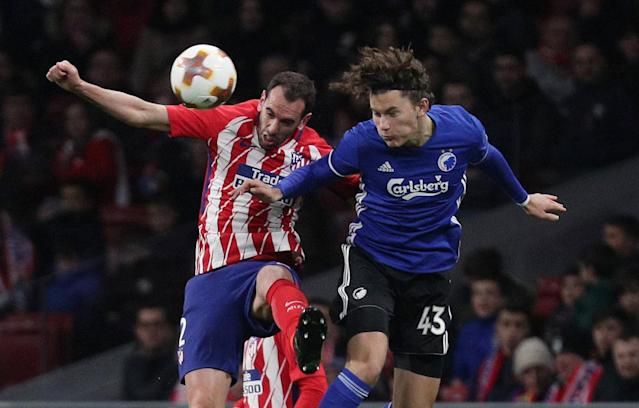 Soccer Football - Europa League Round of 32 Second Leg - Atletico Madrid vs Copenhagen - Wanda Metropolitano, Madrid, Spain - February 22, 2018 Atletico Madrid's Diego Godin in action with FC Copenhagen's Jonas Wind REUTERS/Sergio Perez