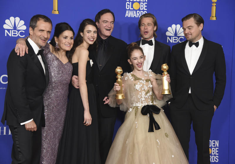 "The cast and crew of ""Once Upon a Time in Hollywood"" pose in the press room with the awards for best motion picture, musical or comedy and best screenplay, motion picture, at the 77th annual Golden Globe Awards at the Beverly Hilton Hotel on Sunday, Jan. 5, 2020, in Beverly Hills, Calif. (AP Photo/Chris Pizzello)"