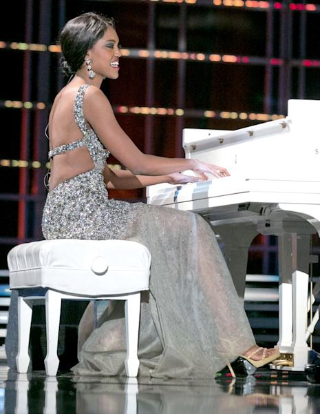 "This photo courtesy Miss America Organization shows Miss North Dakota Rosie Sauvageau took top honors Thursday, Jan. 10, 2013, after her piano and vocal rendition of ""To Make You Feel My Love."" The 24-year-old from Fargo, N.D., will take home a $2,000 Amway scholarship from the competition at Planet Hollywood resort in Las Vegas. (AP Photo/Miss America Organization)"