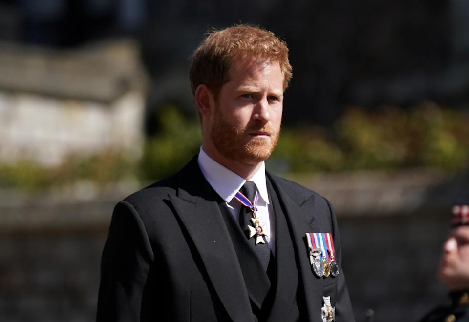 Britain's Prince Harry walking in the procession at Windsor Castle, Berkshire, during the funeral of Britain's Prince Philip, who died at the age of 99, Britain, April 17, 2021. Victoria Jones/Pool via REUTERS