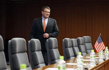 Ashton Carter walks towards his seat at the start of a meeting with Japanese Senior Vice Defence Minister Shu Watanabe (not pictured) in Tokyo July 20, 2012. REUTERS/Yuriko Nakao