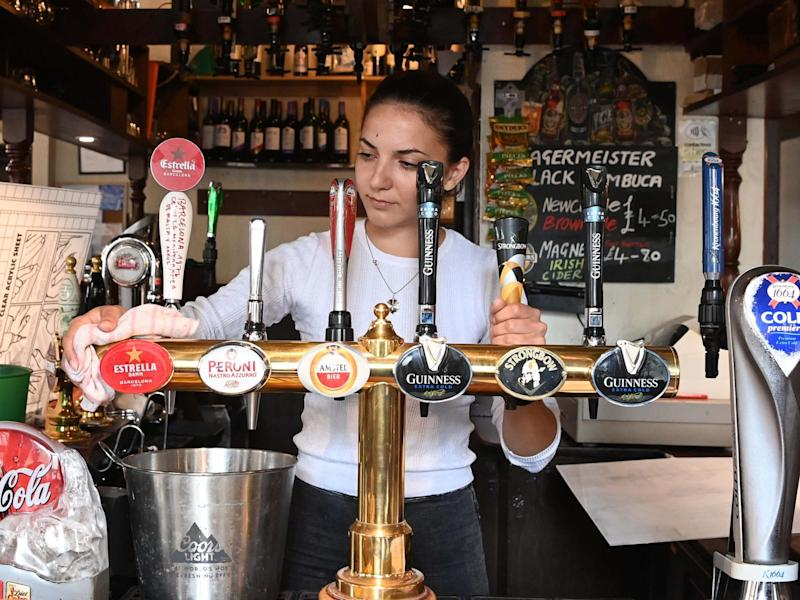 """Pub staff get ready for reopening on """"Super Saturday"""" in London's Soho district: EPA"""