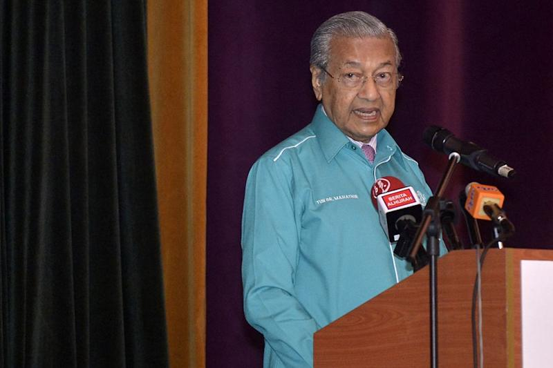 Tun Dr Mahathir Mohamad speaks during the launch of Union of Pos Malaysia Uniformed Staff (UPUS) conference in Shah Alam December 5, 2018. ― Picture by Mukhriz Hazim