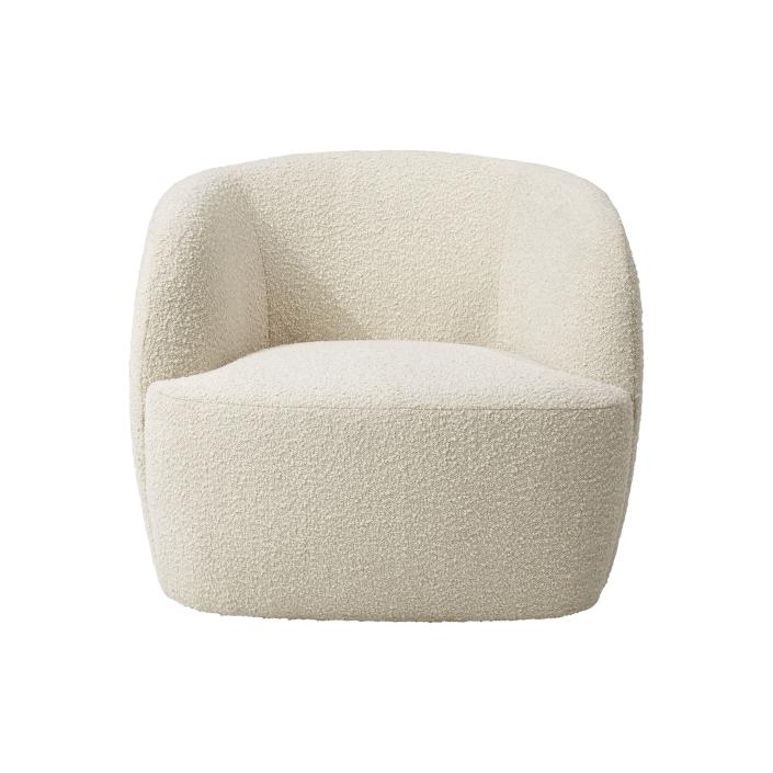 "This undated photo shows CB2's Gwyneth side chair. Designer John McClain, whose studio is in Orlando, says one big trend he's seeing in fall décor is a range of deep, cozy textures like boucle and shearling. ""(They're) are cropping up on more than just pillows these days – entire sofas, chairs and headboards are sporting luscious upholstery reminiscent of lambs, puppies and ponies."" CB2 has several options, including the Gwyneth side chair, Logan sofa and Azalea chair. (CB2 via AP)"