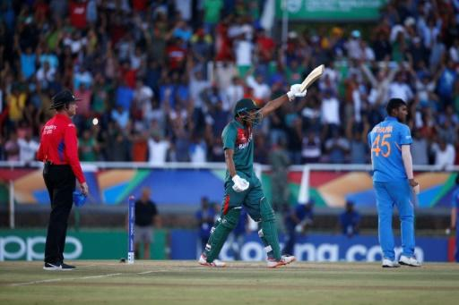Rakibul Hasan salutes the crowd after hitting the winning runs for Bangladesh in the Under 19 World Cup final against India