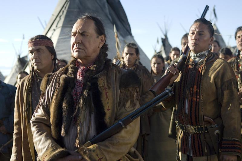 """FILE - This undated file photo supplied by HBO shows actors Eric Schweig, left, August Schellenberg and Nathan Chasing Horse, right, in the HBO film """"Bury My Heart at Wounded Knee."""" Schellenberg, who starred in the """"Free Willy"""" films and appeared in numerous television roles, has died at his Dallas home after a fight with lung cancer, his agent said Friday. He was 77. (AP Photo/HBO, Annabel Reyes, File)"""