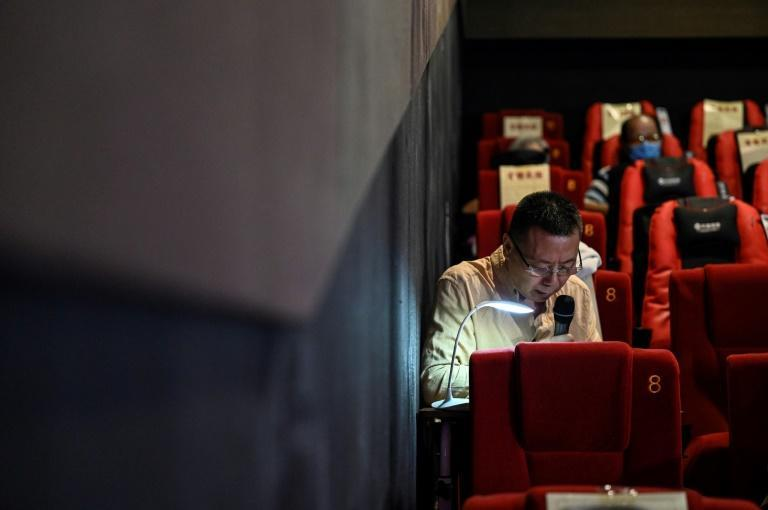 Explaining films to blind audiences can be challenging if the plot has historical or imaginary elements that the audience is yet to encounter (AFP/Jade GAO)