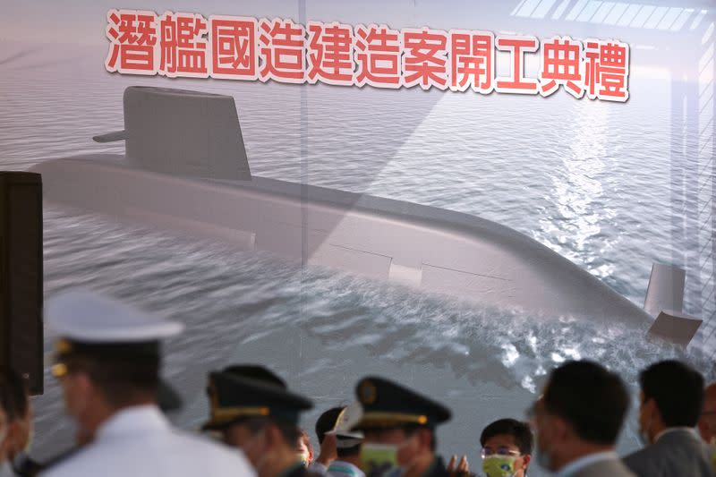 FILE PHOTO: People attend the ceremony for the start of construction of a new submarine fleet in Kaohsiung,