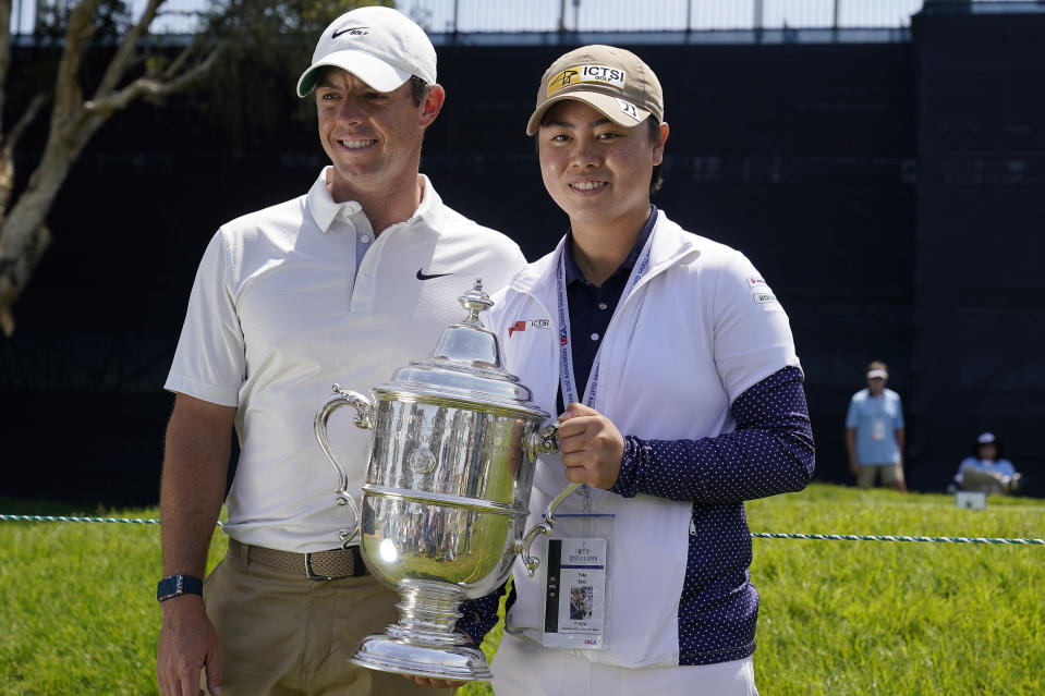 2021 U.S. Women's Open golf champion Yuka Saso, of the Philippines, poses with her champions trophy with Rory McIlroy, of Northern Ireland, during a practice round of the U.S. Open Golf Championship, Tuesday, June 15, 2021, at Torrey Pines Golf Course in San Diego. (AP Photo/Gregory Bull)