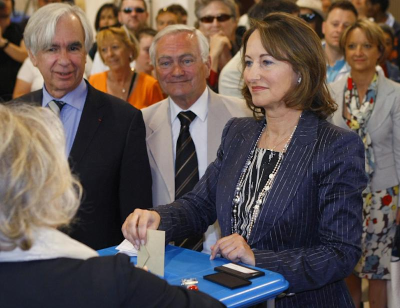 French former Socialist presidential candidate Segolene Royal casts her vote for the legislative elections, Sunday, June 17, 2012, in  La Rochelle, west of France. Royal is facing a Socialist Party opponent in the second round election, and will determine the makeup of the new parliament. (AP Photo/Jacques Brinon)