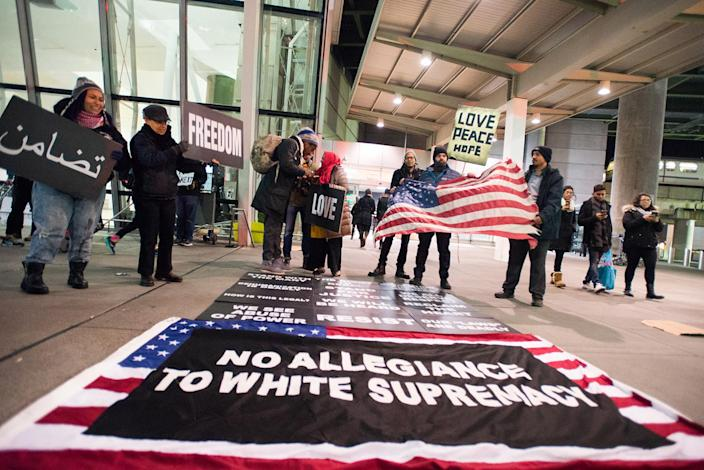 <p>Protestors rally during a demonstration against President Donald Trump's immigration ban, at Kennedy International Airport in New York, Jan. 28, 2017. (Photo: Zach D Roberts/NurPhoto via Getty Images) </p>