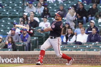 Washington Nationals' Kyle Schwarber (12) hits a two-run home run against the Chicago Cubs during the fourth inning of a baseball game, Monday, May, 17, 2021, in Chicago. (AP Photo/David Banks)
