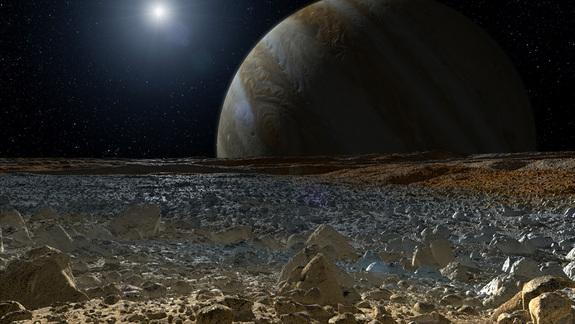 This artist's concept shows a simulated view from the surface of Jupiter's moon Europa. Europa's potentially rough, icy surface, tinged with reddish areas that scientists hope to learn more about, can be seen in the foreground. The giant planet