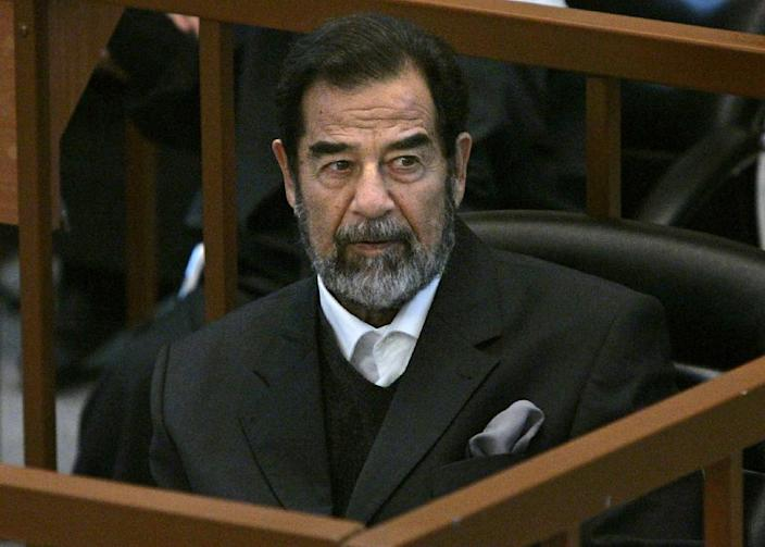 "Ousted Iraqi president Saddam Hussein described his 10-month trial as ""a comedy"" after he was sentenced in 2006 (AFP Photo/Chris Hondros)"