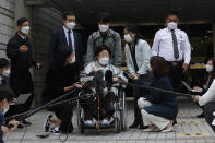 Former South Korean comfort woman Lee Yong-soo in a wheelchair speaks before leaving the Seoul Central District Court in Seoul, South Korea, Wednesday, April 21, 2021. The court on Wednesday rejected a claim by South Korean sexual slavery victims and their relatives who sought compensation from the Japanese government over their wartime sufferings. (AP Photo/Ahn Young-joon)