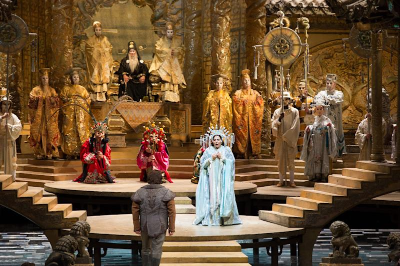 """This Sept. 14, 2012, photo provided by the Metropolitan Opera shows a scene from Puccini's """"Turandot,"""" with Maria Guleghina , center right, in the title role, addressing Marco Berti as Calaf, foreground, during a dress rehearsal at the Metropolitan Opera in New York. (AP Photo/Metropolitan Opera, Marty Sohl)"""