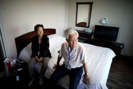 Park Kab-il and Baek Seong-yeon who have been selected as participants for a reunion rest at a hotel used as a waiting place in Sokcho, South Korea, August 19, 2018. REUTERS/Kim Hong-Ji