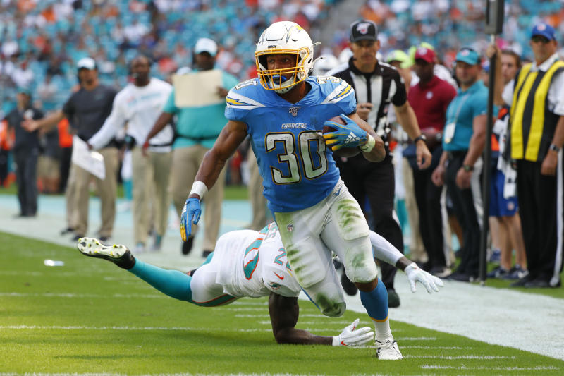 Miami Dolphins free safety Reshad Jones (20) misses a tackles as Los Angeles Chargers running back Austin Ekeler (30) runs for a touchdown, during the first half at an NFL football game against the Miami Dolphins, Sunday, Sept. 29, 2019, in Miami Gardens, Fla. (AP Photo/Wilfredo Lee)