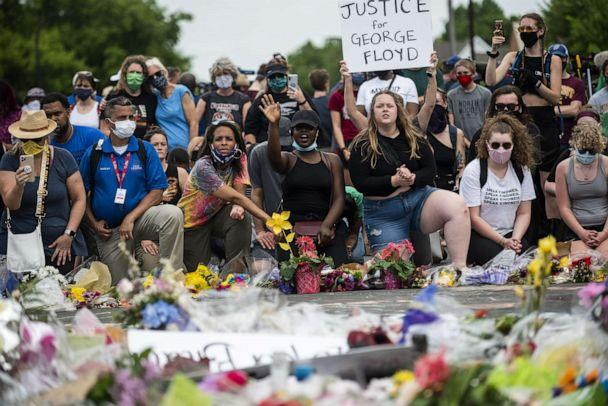 PHOTO: People gather on June 1, 2020, in Minneapolis, at site where George Floyd died May 25 while in police custody. (Stephen Maturen/Getty Images)