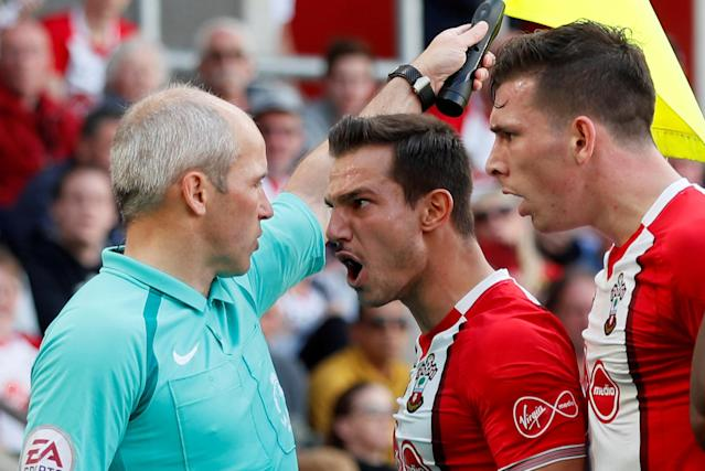 "Soccer Football - Premier League - Southampton vs Manchester City - St Mary's Stadium, Southampton, Britain - May 13, 2018 Southampton's Cedric Soares and Pierre-Emile Hojbjerg remonstrate with a linesman REUTERS/David Klein EDITORIAL USE ONLY. No use with unauthorized audio, video, data, fixture lists, club/league logos or ""live"" services. Online in-match use limited to 75 images, no video emulation. No use in betting, games or single club/league/player publications. Please contact your account representative for further details. TPX IMAGES OF THE DAY"