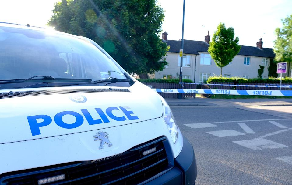 A police van at the scene of a suspected stabbing in Coventry (SWNS)