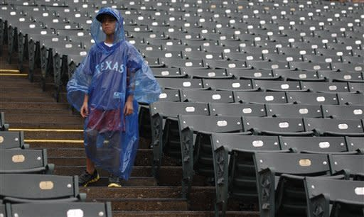 A young fan stands in empty stands because of a rain delayed start of the baseball game between the Los Angeles Angels and Texas Rangers Saturday, Sept. 29, 2012, in Arlington, Texas. (AP Photo/LM Otero)