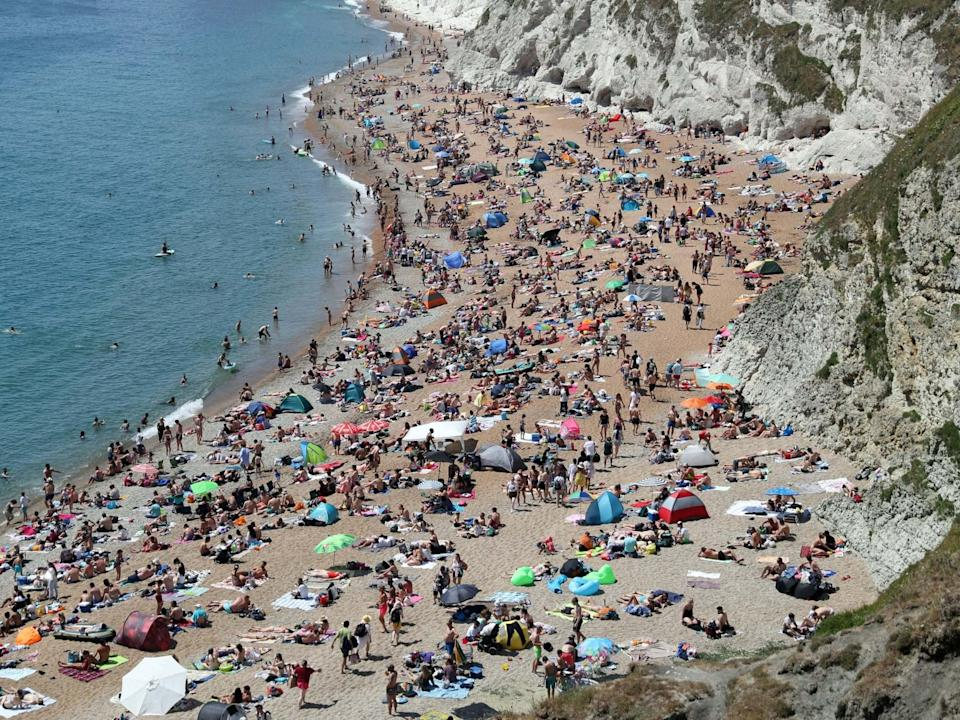 <p> The beach at Durdle Door was crowded  over the summer</p> (Andrew Matthews/PA Wire)
