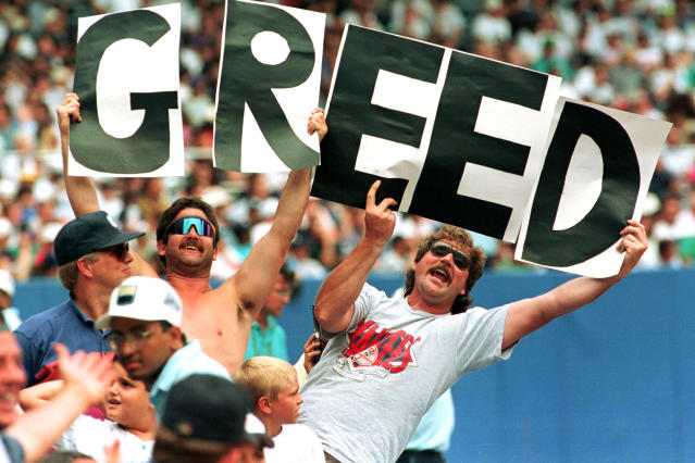 Baseball fans at Yankee Stadium hold up letters spelling the word Greed during the New York Yankees game against the Toronto Blue Jays in New York City, Thursday, Aug. 11, 1994. (AP)