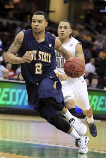 Kent State's Michael Porrini (2) drives to the basket against Akron's Alex Abreu (11) during the first half of an NCAA college basketball game in the semifinals of the Mid-American Conference men's tournament, Friday, March 9, 2012, in Cleveland. (AP Photo/Tony Dejak)