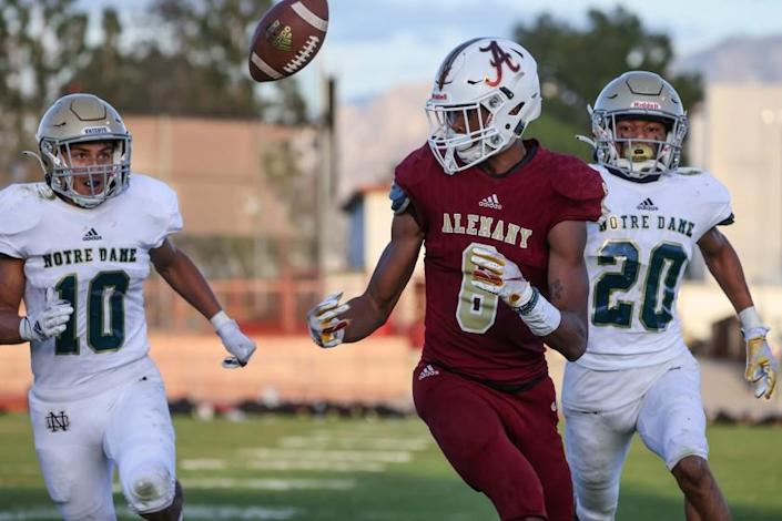 Mission Hills, CA, Friday, March 19, 2021 - Bishop Alemany receiver Ephesians Prysock juggles a long pass for a touchdown over Notre Dame defenders Ruben Solorzano, 10, and Kyle Wynn, 20, in the second half at Alemany. (Robert Gauthier/Los Angeles Times)