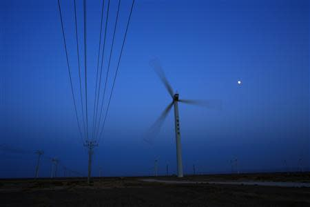 A wind turbine for generating electricity is seen at a wind farm in Guazhou, 950km (590 miles) northwest of Lanzhou, Gansu Province September 15, 2013. REUTERS/Carlos Barria