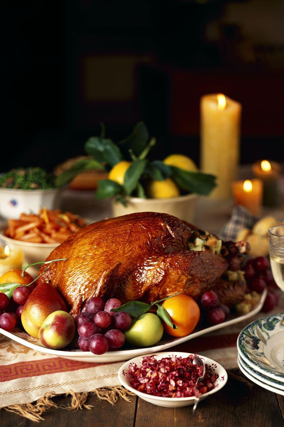 """<p>The lush color and rich harvest of autumn fruit—persimmons, pomegranates, and quinces—are incorporated in this menu.</p><p><strong>Starters:</strong></p><p><a href=""""https://www.countryliving.com/food-drinks/recipes/a1123/roasted-lemon-dip-3229/"""" rel=""""nofollow noopener"""" target=""""_blank"""" data-ylk=""""slk:Roasted Lemon Dip"""" class=""""link rapid-noclick-resp"""">Roasted Lemon Dip</a></p><p><strong>Main Course:</strong></p><p><a href=""""https://www.countryliving.com/food-drinks/recipes/a1017/roast-turkey-pomegranate-sauce-3126/"""" rel=""""nofollow noopener"""" target=""""_blank"""" data-ylk=""""slk:Roast Turkey with Pomegranate Sauce"""" class=""""link rapid-noclick-resp"""">Roast Turkey with Pomegranate Sauce</a></p><p><strong>Side Dishes:</strong></p><p><a href=""""https://www.countryliving.com/food-drinks/recipes/a1836/cornbread-quince-pecan-stuffing-3959/"""" rel=""""nofollow noopener"""" target=""""_blank"""" data-ylk=""""slk:Cornbread, Quince, and Pecan Stuffing"""" class=""""link rapid-noclick-resp"""">Cornbread, Quince, and Pecan Stuffing</a></p><p><a href=""""https://www.countryliving.com/food-drinks/recipes/a982/double-stuffed-potatoes-3082/"""" rel=""""nofollow noopener"""" target=""""_blank"""" data-ylk=""""slk:Double-Stuffed Potatoes"""" class=""""link rapid-noclick-resp"""">Double-Stuffed Potatoes</a></p><p><a href=""""https://www.countryliving.com/food-drinks/recipes/a954/roasted-cauliflower-cumin-3057/"""" rel=""""nofollow noopener"""" target=""""_blank"""" data-ylk=""""slk:Roasted Cauliflower with Cumin"""" class=""""link rapid-noclick-resp"""">Roasted Cauliflower with Cumin</a></p><p><a href=""""https://www.countryliving.com/food-drinks/recipes/a1822/creamy-brussels-sprouts-3946/"""" rel=""""nofollow noopener"""" target=""""_blank"""" data-ylk=""""slk:Creamy Brussels Sprouts"""" class=""""link rapid-noclick-resp"""">Creamy Brussels Sprouts</a></p><p><strong>Desserts:</strong></p><p><a href=""""https://www.countryliving.com/food-drinks/recipes/a1231/pomegranate-apple-cocktails-3337/"""" rel=""""nofollow noopener"""" target=""""_blank"""" data-ylk=""""slk:Hot Pomegranate-Apple Cider"""" class=""""link rapid-noclick-resp"""">Hot Pomegran"""