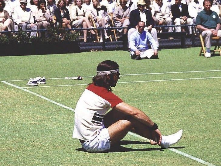 """Richie Tenenbaum (Luke Wilson) sits dejectedly on a tennis court in front of a crowd of onlookers in this scene from """"The Royal Tenenbaums."""""""