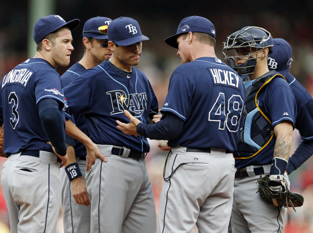 Tampa Bay Rays pitching coach Jim Hickey (48) talks to starting pitcher Matt Moore, second from left, in the fourth inning in Game 1 of baseball's American League division series against the Boston Red Sox, Friday, Oct. 4, 2013, in Boston. (AP Photo/Michael Dwyer)