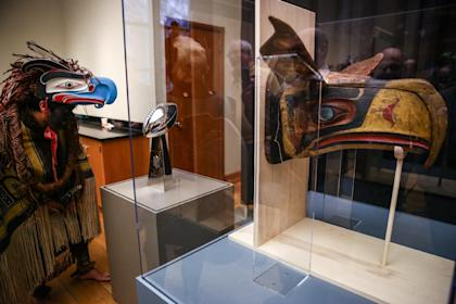The mask that inspired the Seahawks logo, right, is unveiled at the Burke Museum at in Seattle. (AP Photo)