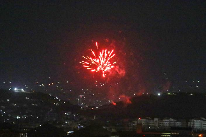 Celebratory gunfires light up part of the night sky after the last US aircraft took off from the airport in Kabul early on August 31, 2021. (AFP via Getty Images)
