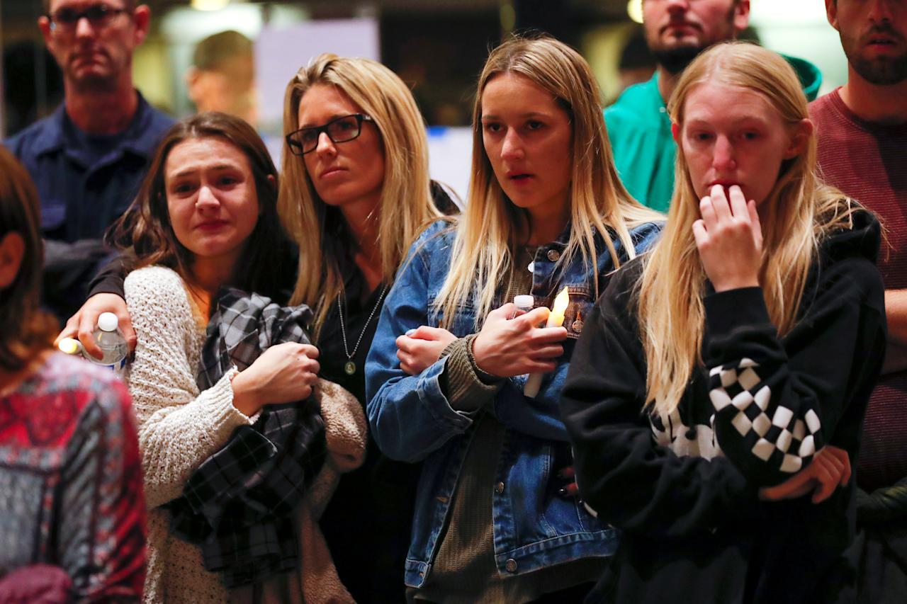 <p>Mourners attend a vigil for the victims of the mass shooting, at the Thousand Oaks Civic Arts Plaza in Thousand Oaks, Calif., Nov. 8, 2018. (Photo: Mike Blake/Reuters) </p>