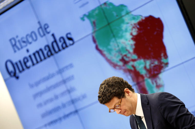 """Brazil's environment minister Ricardo Salles, hears questions about the fires in the Amazon after speaking to the Environment Committee of the House of Representatives, in Brasilia, Brazil, Wednesday, Oct. 9, 2019. According to authorities an oil spill has now reached 61 municipalities in nine Brazilian states, contaminating over 130 beaches, in what Brazilian officials have called an """"unheard of"""" disaster. Salles said a report from state oil company Petrobras indicates the oil comes from Venezuela. (AP Photo/Eraldo Peres)"""