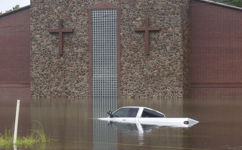 A truck sits largely submerged in floodwater in front of a church on Sept. 19, 2019, in Vidor, Texas, following flooding from Tropical Depression Imelda. (Photo: Ryan Welch/The Beaumont Enterprise via AP)