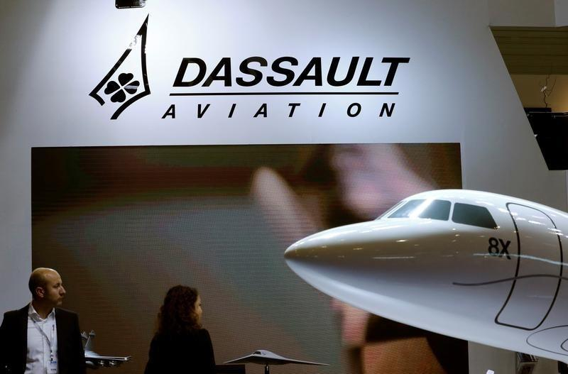 A Dassault Aviation logo is pictured on the company booth during the European Business Aviation Convention & Exhibition (EBACE) at Cointrin airport in Geneva, Switzerland, May 24, 2016. REUTERS/Denis Balibouse/Files