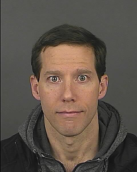 "This photo provided by Denver Police shows Aron Ralston, 38. Ralston, who cut off his forearm to free himself after becoming trapped by a dislodged boulder in a Utah canyon, has been arrested in Denver for domestic violence. He was booked into the Downtown Detention Center on Sunday, Dec. 8, 2013 on charges of assault and wrongs to minors. Ralston was hiking in 2003 when he became trapped by a boulder and was forced to cut off his own arm to free himself. He went on to detail his struggles in a book, and his story was later adapted into the movie ""127 Hours."" (AP Photo/Denver Police)"