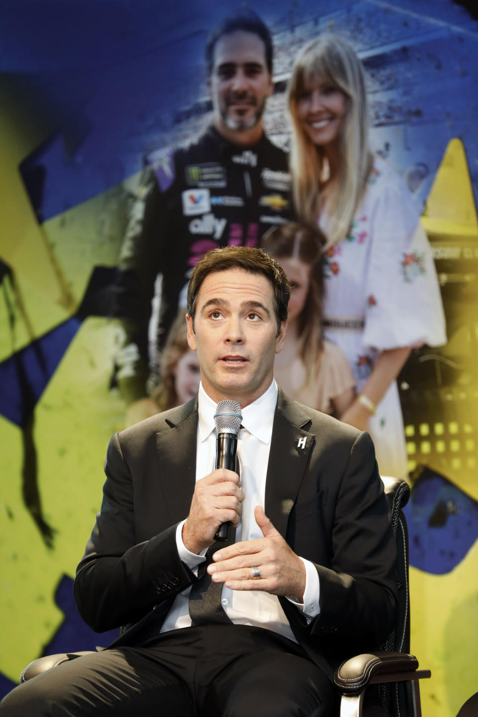 NASCAR driver Jimmie Johnson pauses during his retirement from driving announcement at Hendrick Motorsports near Charlotte, N.C., Thursday, Nov. 21, 2019. (AP Photo/Bob Leverone)