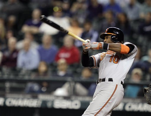 Baltimore Orioles' Adam Jones hits a two-run home run in the 11th inning of a baseball game against the Seattle Mariners, Wednesday, Sept. 19, 2012, in Seattle. (AP Photo/Ted S. Warren)