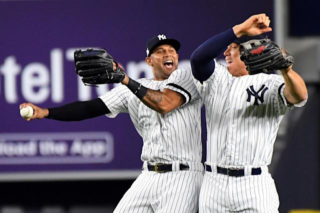 Oct 18, 2017; Bronx, NY, USA; New York Yankees center fielder Aaron Hicks (31) and right fielder Aaron Judge (99) celebrates after beating the Houston Astros in game five of the 2017 ALCS playoff baseball series at Yankee Stadium. (USA TODAY Sports)